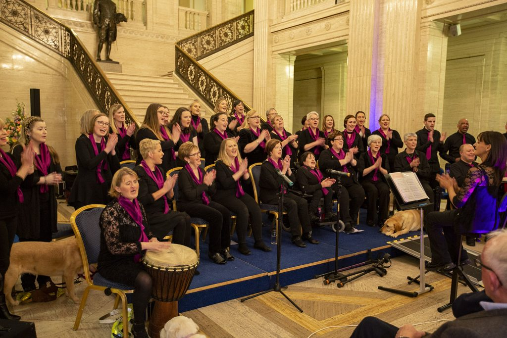 Choir performing at the foot of the steps in the great hall in Stormont