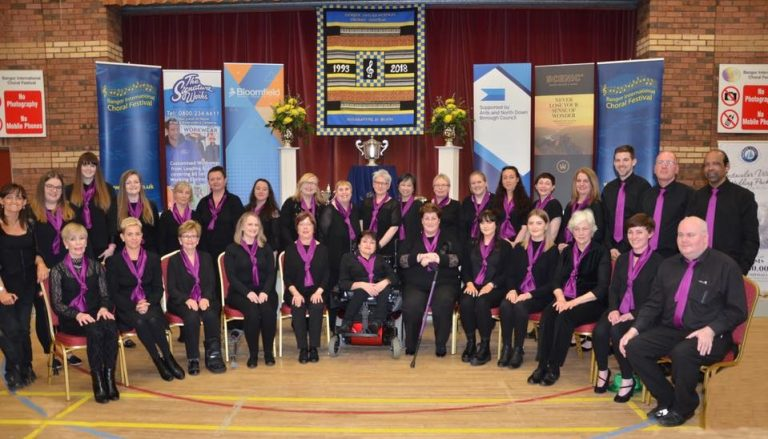 Picture of choir on stage at Bangor choral festival in 2018